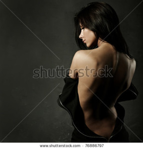stock-photo-beautiful-woman-in-sexy-evening-dress-against-dark-background-76886797