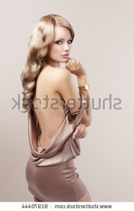 stock-photo-very-beautiful-and-attractive-young-blond-woman-in-elegant-silk-dress-and-with-old-fashion-hair-91970444
